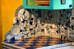Note to self - this is what you need to do with all that broken china you're saving for mosaics.  Beserra cottage kitchen.