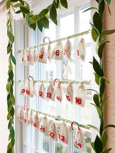 With all the staring outside that happens now (searching for snow or flying reindeer), why not give a prominent window some attention, too? Dress it up with an Advent calendar of muslin bags filled with treats; drape a garland of pinking-sheared leaves along its frame.