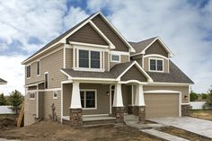 Sherwin William Tavern Taupe new houses, black doors, exterior houses, color stories, exterior colors, house paint colors, new construction, siding colors, exterior house colors