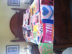 My daughter's fifth grade graduation quilt.  It has t-shirts that span 3-K to 5th grade.