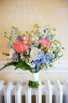 Love the blue and coral tones. The varied heights of the flowers makes for an interesting bouquet.