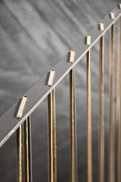 Casa do Conto. Handrail detail with leather inserts.