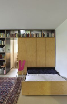 409 sq. ft apartment for a family of 3. Bed slides out from under the room behind it.