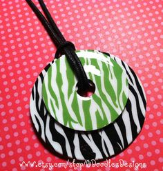 """Cute Zebra Washer Necklace!! 1 1/2' pendant (made from a washer) sits atop a precious 2"""" washer pendant.     http://www.etsy.com/shop/BDoodlesDesigns"""