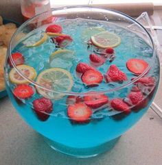 Pirate Punch, at least that's what we called it at my baby shower!    1 part blue poweraid, 2 parts sprite, and cut up fruit for looks and a little extra flavor c: