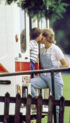 William giving his mother a kiss