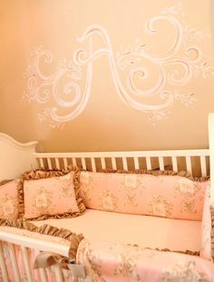 This pretty #pink #monogram #mural matches the #floral bedding perfectly!  #nursery