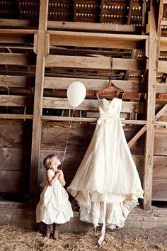 Barn and a wedding dress.