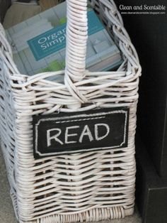 Clean & Scentsible: Book Basket.  Paint an old wicker basket and add a chalk board sign.