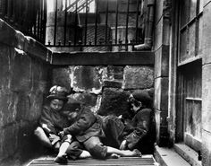 Three urchins huddling for warmth in New York's Lower East Side, 1889.  By Jacob Riis