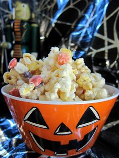 Monster Munch | 1 package Almond Bark (1 lb)2 bags of microwave popcorn, popped (approximately 16-20 C popped popcorn)1 C candy corn1 1/2 C dry roasted, salted peanuts1 C Reeces PiecesPop popcorn and place in a large bowl. The largest you have.  Pour peanuts, candy corn, and reeces pieces on top.Break up almond bark. Melt according to package directions. Pour over popcorn mixture. Stir until everything is well coated and then spread out onto waxed paper, parchment, or foil. Let sit until complet