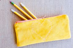 DIY: cross stitch leather pencil case