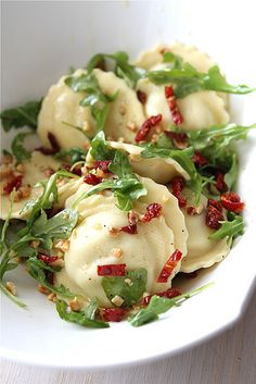 Roasted Chicken and Mozzarella Ravioli with Sun Dried Tomatoes, Arugula, and Hazelnuts
