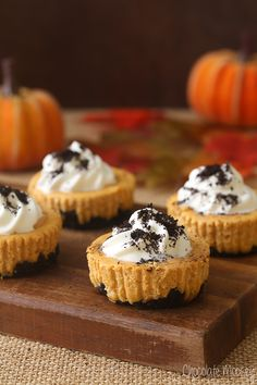 Mini Pumpkin Oreo Cheesecakes are festive without too much fuss. Serve this black and orange dessert for Halloween or for Thanksgiving.
