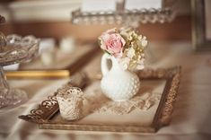 examples of milk glass and lace centerpieces for H's wedding and I love the frame