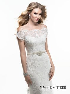 Brides of Brisbane Chermside .... Cold shoulder, portrait neckline with embellished shoe string straps and Swarovski crystal neckline adorn this lightweight A-line gown. Scalloped lace trails to a crystal button over zipper back closure. Colours Available: White, Ivory or Ivory over Pearl (Shown)