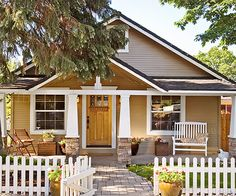 Multipane windows with wide trim replaced the old versions, and a new stained front door and a charming picket fence announce both entry and border to passersby: http://www.bhg.com/home-improvement/exteriors/curb-appeal/entryway-designs/?socsrc=bhgpin102814enhancehiddenfeatures&page=12