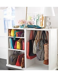 traditional bookcase is transformed into a handbag shelf