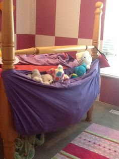 Repurpose a fitted sheet into a Stuffed animal hammock. Going to add some elastic strips vertically to provide more support. Great start so far and super easy!