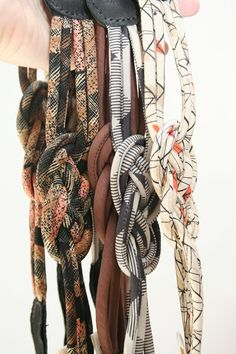 fabric knot belts. @Sue Goldberg H Slakter, maybe could replicate? would be good for fabric scraps; could be mixey-matchey.