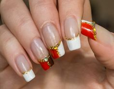 french-manicure-with-gold-glitter-and-rhinestones