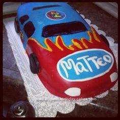 Homemade Nascar Birthday Cake: I made this NASCAR birthday cake for my friend's son's birthday. He absolutely loves NASCAR's.   The car is made from pound cake and covered with fondant