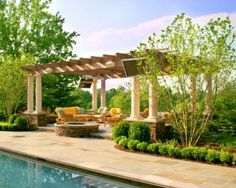 Pergola. Love the built in firepit and beautiful columns