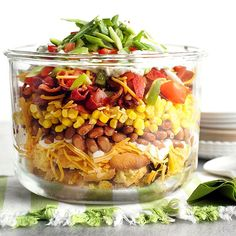 Mississippi Corn Bread Salad Bring a gorgeous layered salad thats loaded with Southern charm to your next get-together. More potluck recipes: http://www.bhg.com/recipes/party/seasonal/spring-potluck-sides-and-salads/