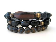 Beaded bracelet stack featuring midnight blue tiger eye chunks, deep blue faceted glass beads, sapphire pyrite beads, oxidized brass beads and an ebony zebra wood focal bead by Rock & Hardware Jewelry