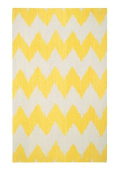 Yellow chevron rug.
