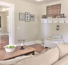 Living room color - the paint on the walls is Manchester Tan by Benjamin Moore.