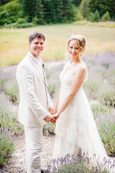 Bride & Groom in a Lavender Field! Romantic! Wedding Gown by Pronovias. See the wedding on SMP: http://www.StyleMePretty.com/northwest-weddings/2014/02/04/romantic-woodland-wedding/ Aura May Photography