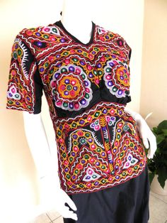 Vintage Embroidered Glistening Ethnic Top. $65.00, via Etsy.