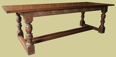 Hand carved refectory dining table, handmade in oak, decorated with running vine carving (or 'vine trail', popular during the gothic and renaissance periods) and twin centre stretchers.