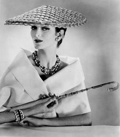 Carmen Dell'Orefice wearing a straw hat from Mr John's 'Directoire' collection for spring/summer 1956.