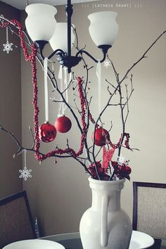love the use of a pitcher to hold branches. also could string cranberries for the rope.