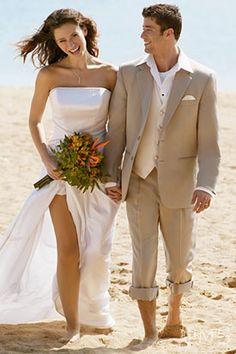 Gorgeous beach dress, love his suit