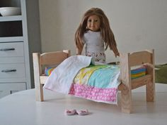"Kid's Kit: Doll Bed - Ana White has a ""kit"" you can assemble and have your child make their own doll bed. And only costs about $2 to make."