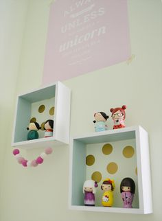mini wooden box shelves for display with felt ball garland and UrbanWalls mini gold dot decals.