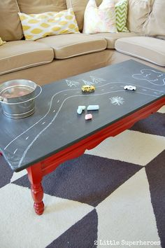 Paint a laminate coffee table with chalkboard table. Perfect for a playroom. #chalkboardpaint