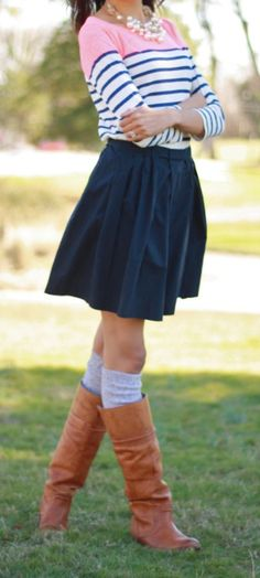 great black, white, and pink striped shirt. Paired with a knee length navy skirt and tall tan boots. LOVE
