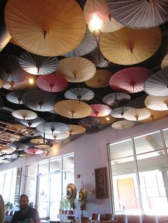 paper parasols, if we have a little girl one day, I'm totally doing this to her room!