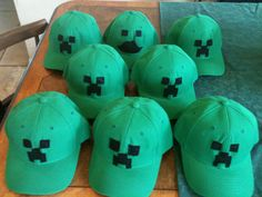 Minecraft creeper hats the party boys made with hats from the t-shirt store, black felt, and liquid stitch