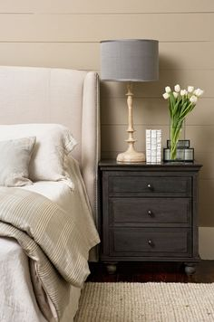 bedrooms - mocha walls wall panels groove walls espresso stained 3 drawer nightstand jute rug ivory linen wingback headboard nailhead trim wood lamp gray linen lamp shade greige linen bedding