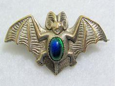 Art Nouveau silvertone bat brooch