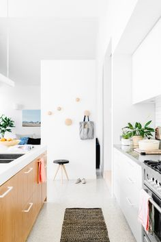 Kitchen with Dots hooks by Muuto. Photo by Brooke Holm.