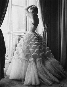 Interesting scallop detail! Model Jean Patchett wearing evening dress by Christian Dior Vogue 1950.