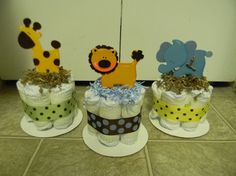 Jungle theme mini diaper cake baby shower for centerpieces- use cutouts from diy project or add cute stuffed animals to top it off :)