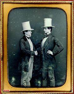 tuesday-johnson:    ca. 1850's, [daguerreotype portrait of two gentlemen in white beaver fur hats posed, shaking hands]  via the Daguerreian Society, Mark Koenigsberg Collection