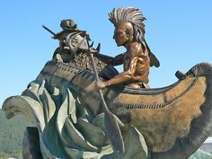 Bronze Sculpture of Native American and Fur Trapper outside of Cabelas Outdoor Outfitters in Hamburg Pennsylvania by mharrsch, via Flickr
